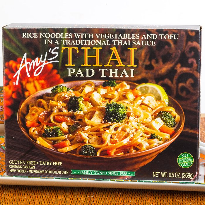 """""""Amy's THAI Pad Thai"""" frozen dinner in Oriental Setting with colorful dishes and chopsticks on bamboo place mat."""
