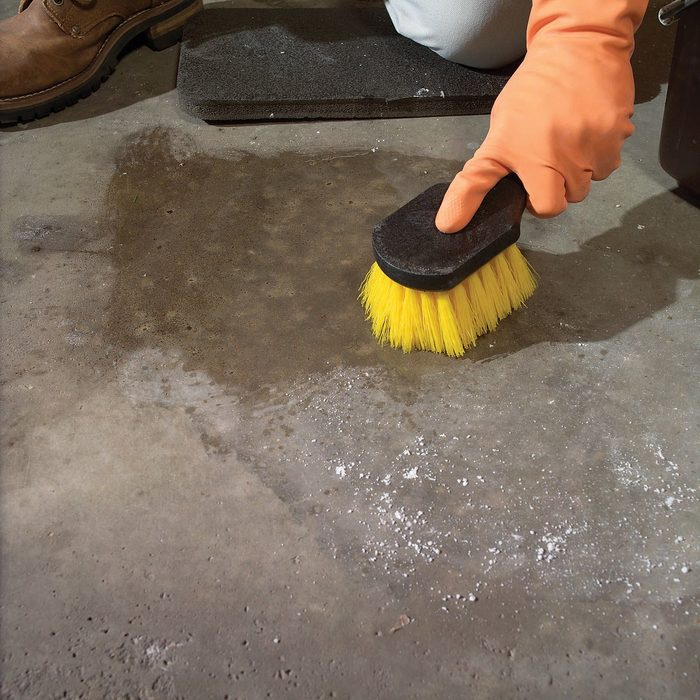 Removing oil with a brush