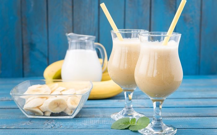 banana daiquiri in glass on a wooden rustic table