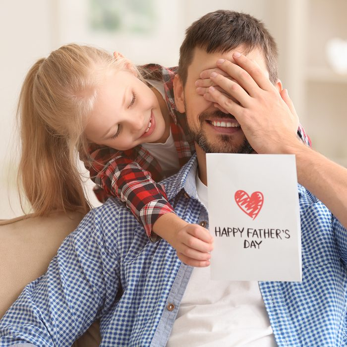 Cute little girl greeting her dad with Father's Day at home; Shutterstock ID 773342551; Job (TFH, TOH, RD, BNB, CWM, CM): Taste of Home