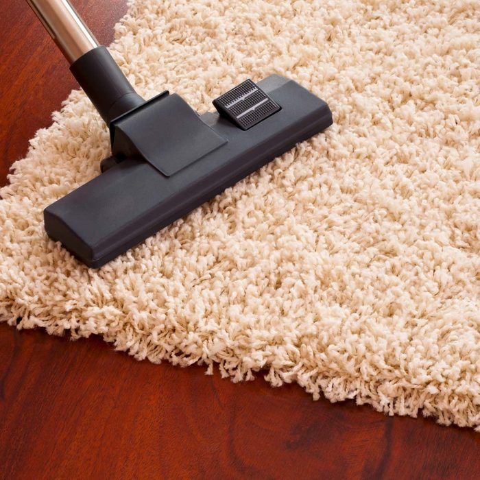 Vacuuming rug