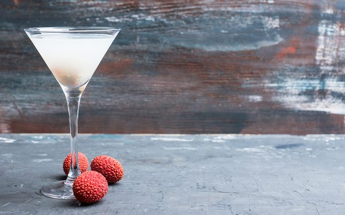 Sweet lychee martini on the rustic background.