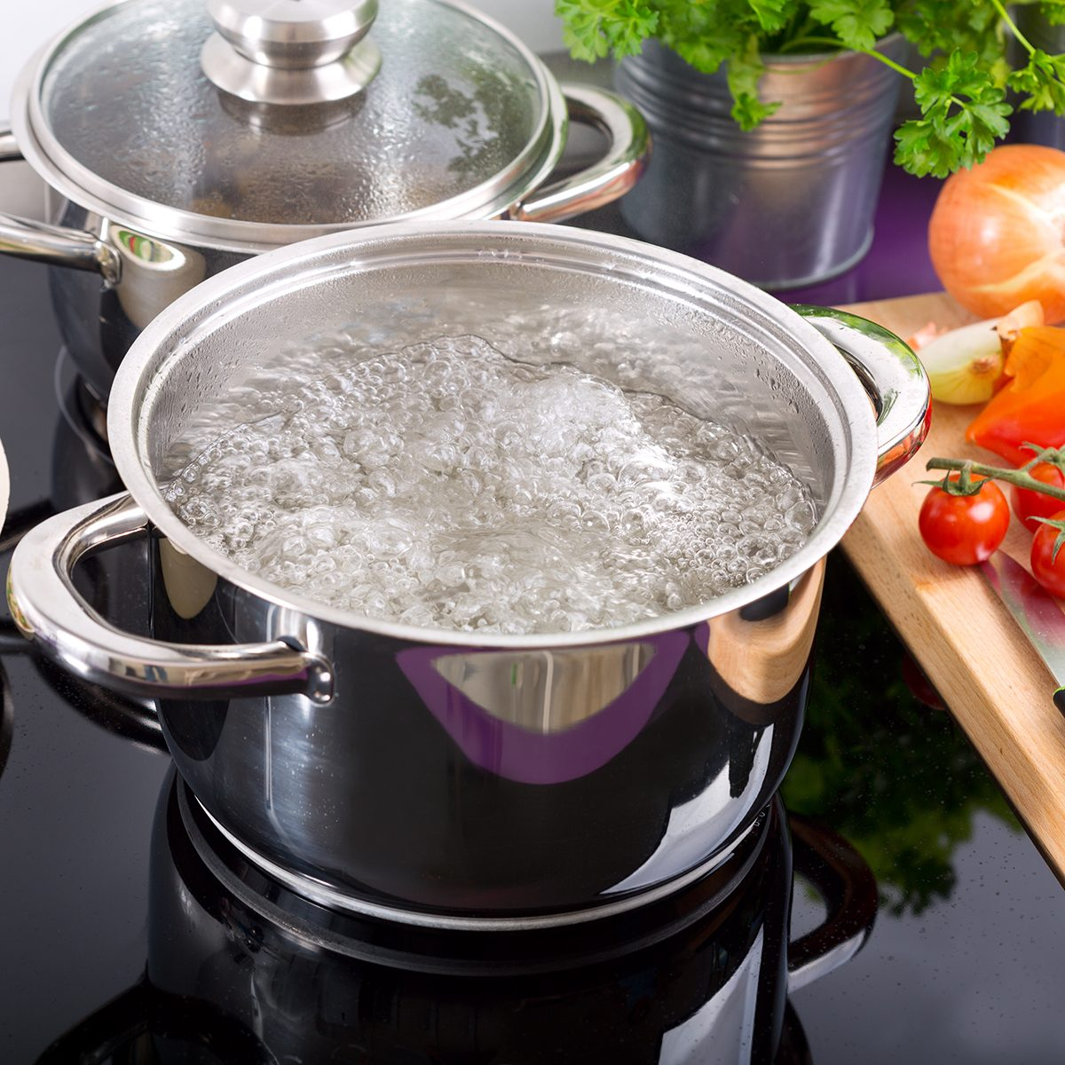 pan of boiling water on the cooker in the kitchen;