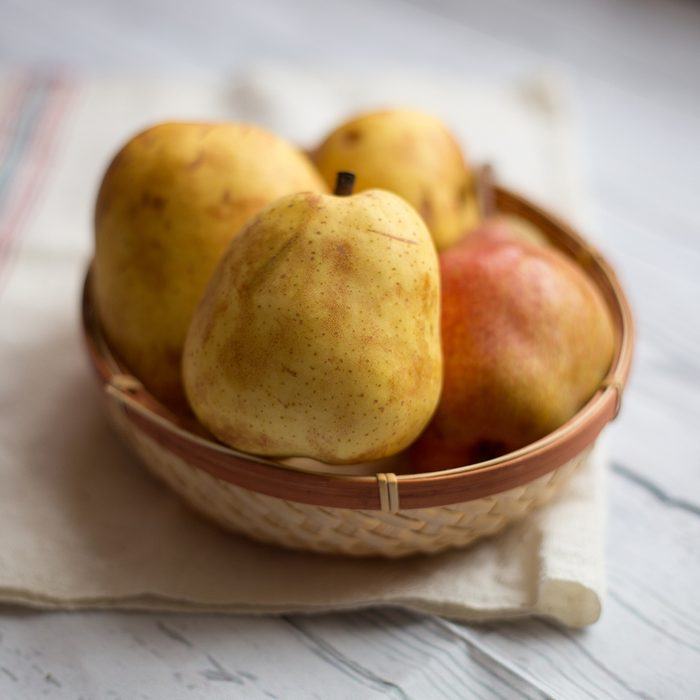fruits for diabetics Fruit background. Fresh organic pears on old wood.