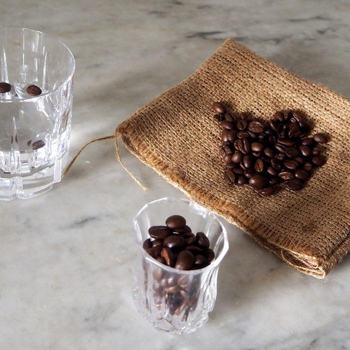 Glass of sambuca , italian liqueur, with coffee beans