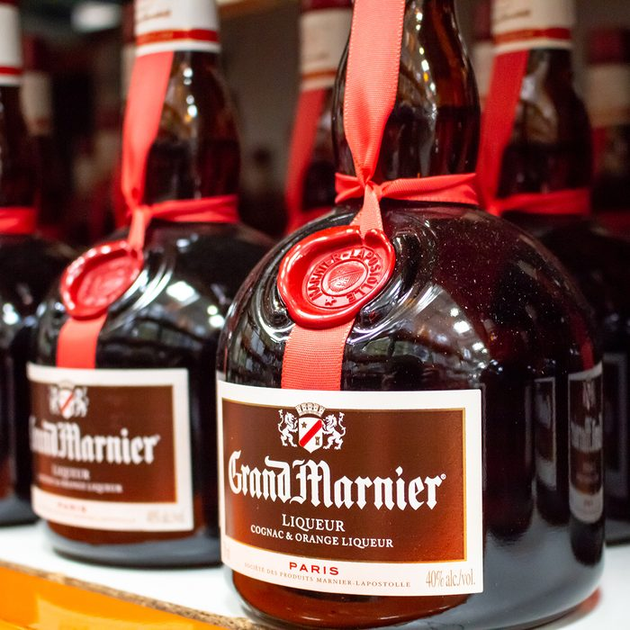 A shelf of Grand Marnier glass bottles, at Costco