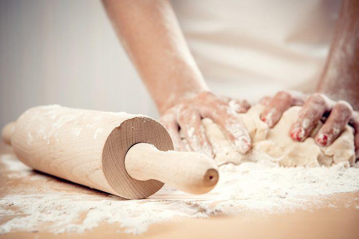 Woman kneading dough, close-up photo; Shutterstock ID 139422398