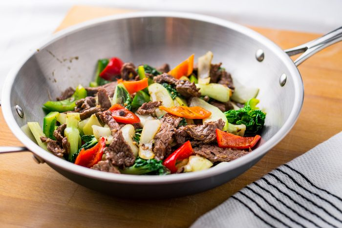 Beef stir-fry with healthy vegetables. Made with flank steak, peppers, onions and bok choy, stir fried in an asian wok