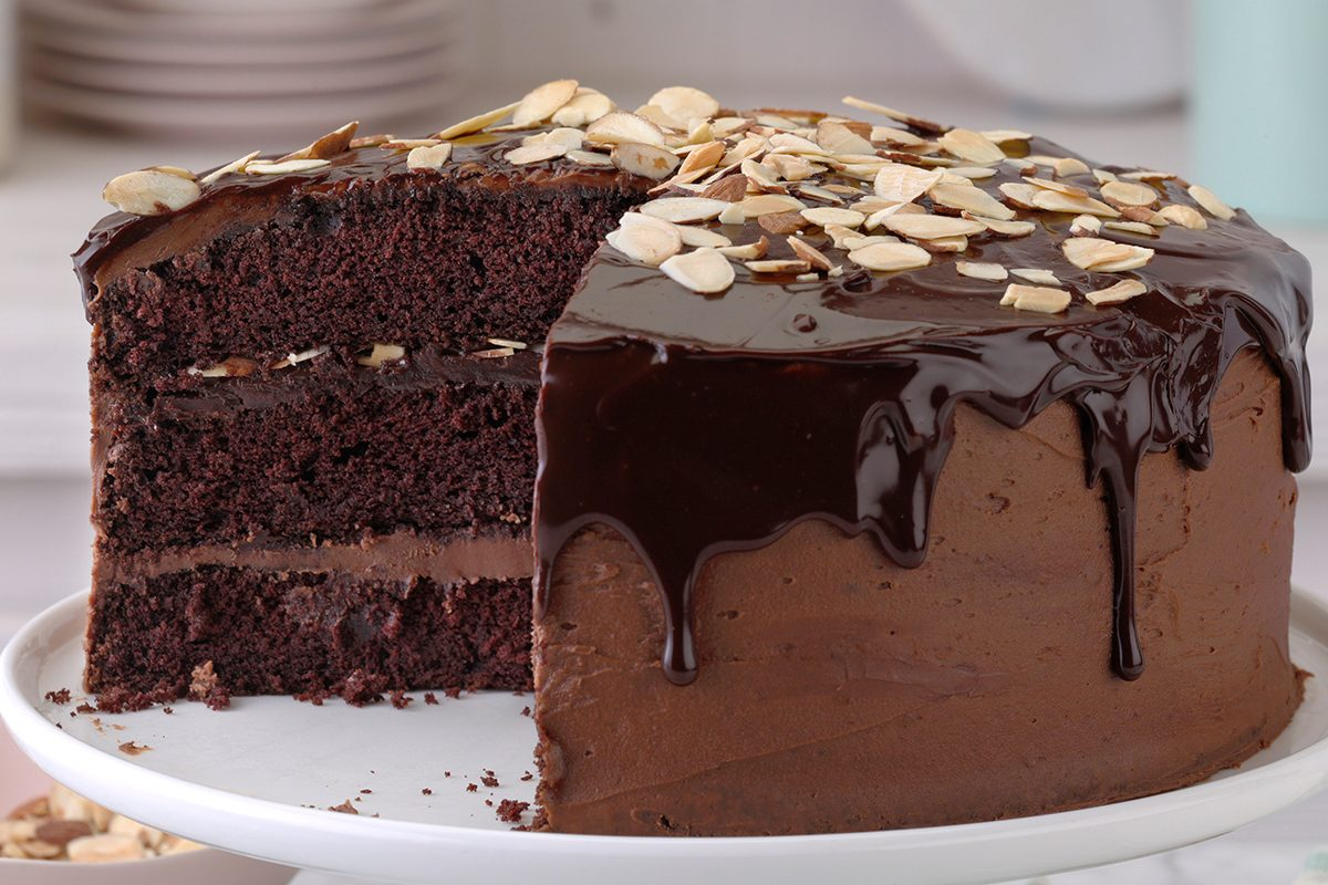 Special-occasion layer cake, chocolate layer cake with chocolate ganache dripping down.