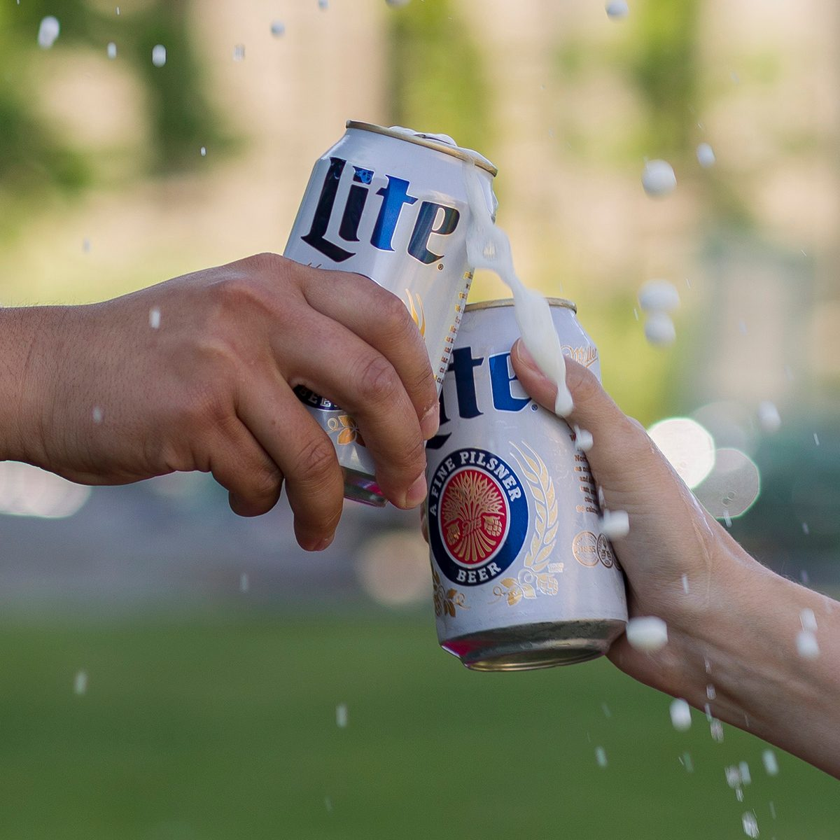 Toasting cans of Miller Lite