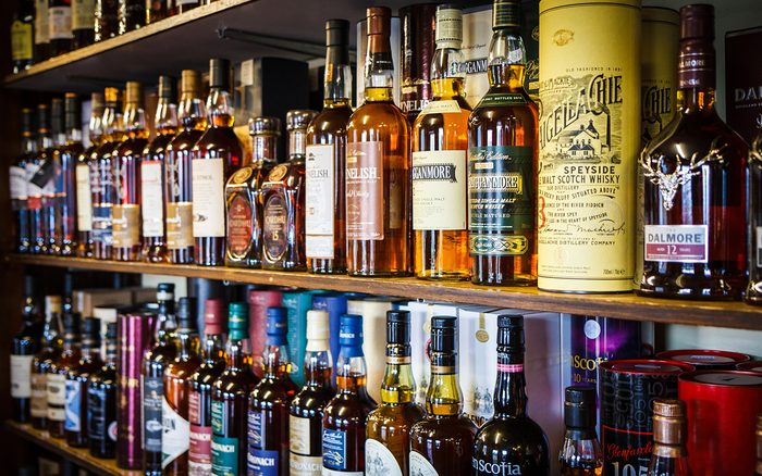 Various bottles of Scotch whisky on the shelf on May 16, 2015 in Tomintoul, UK.