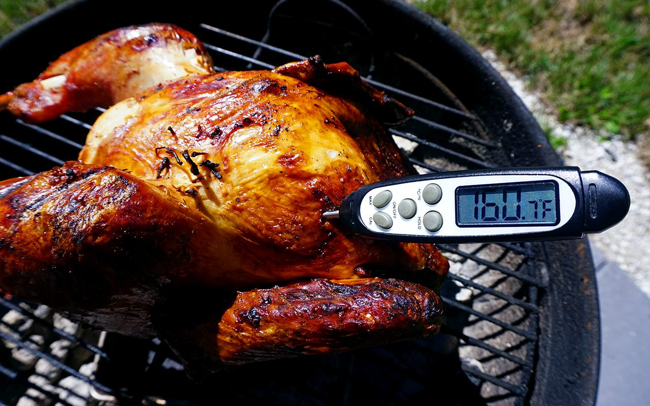 removing the turkey from the grill when the breast reaches 160 degrees