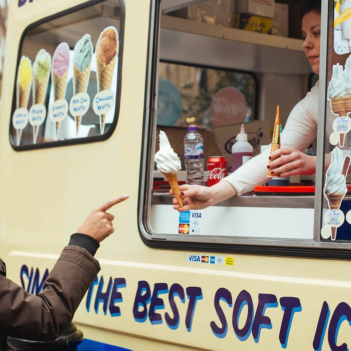 woman buying soft ice cream in the ice cream van near Covent Garden in London