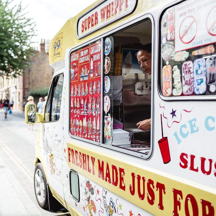 Ice cream truck standing and serving people on the hot weather in London.
