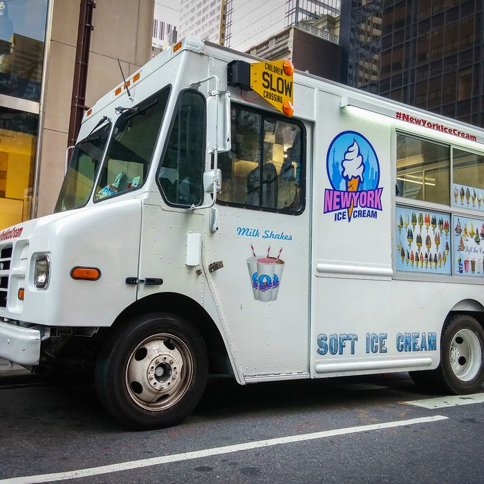 White ice cream truck on a street in New York City - July 1, 2015, 51st street and 5th avenue, New York City, NY, USA