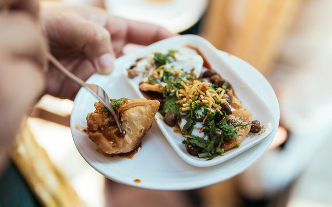 Papri Chaat is traditionally prepared using crisp fried dough wafers known as papri, along with boiled chick peas, boiled potatoes, yogurt and tamarind chutney and topped with chaat masala and sev.