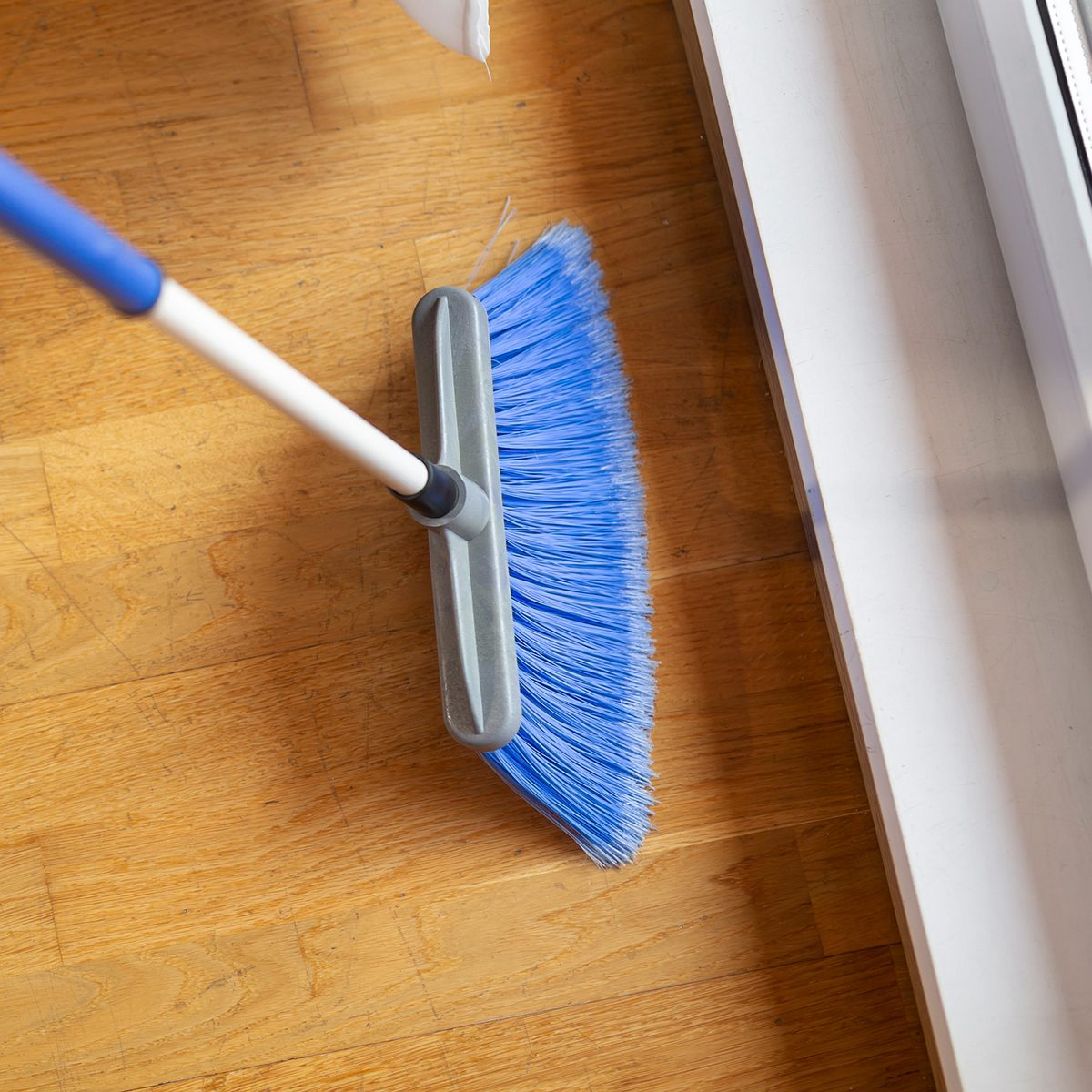 High angle view of female hands holding a broom and sweeping floor; Shutterstock ID 1223043931; Job (TFH, TOH, RD, BNB, CWM, CM): TOH