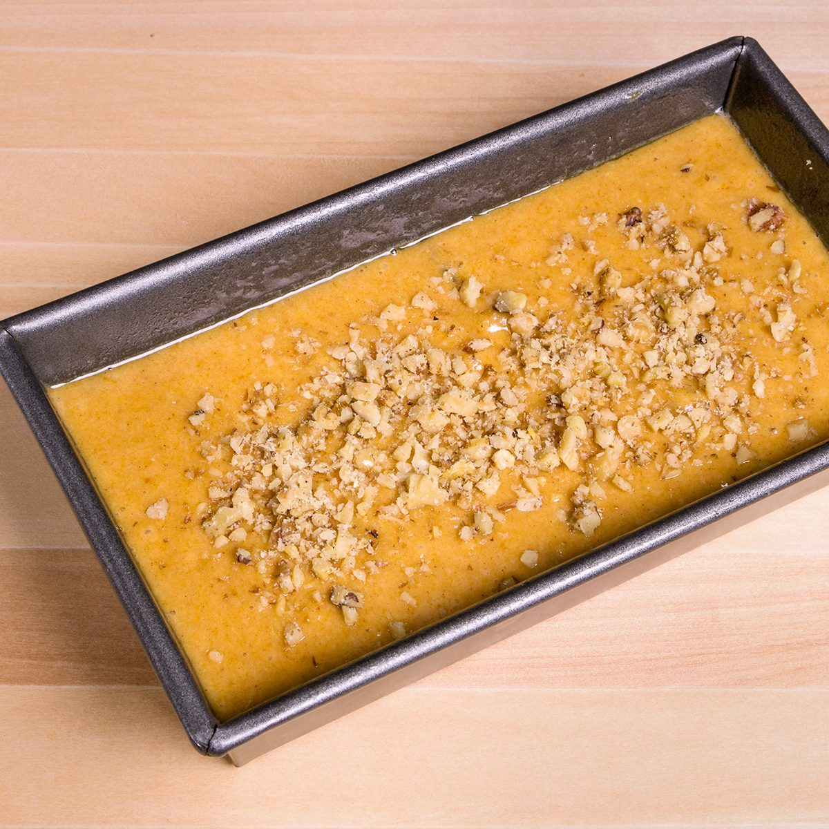 Pumpkin bread batter in a loaf pan ready for the oven; Shutterstock ID 130220897; Job (TFH, TOH, RD, BNB, CWM, CM): TOH