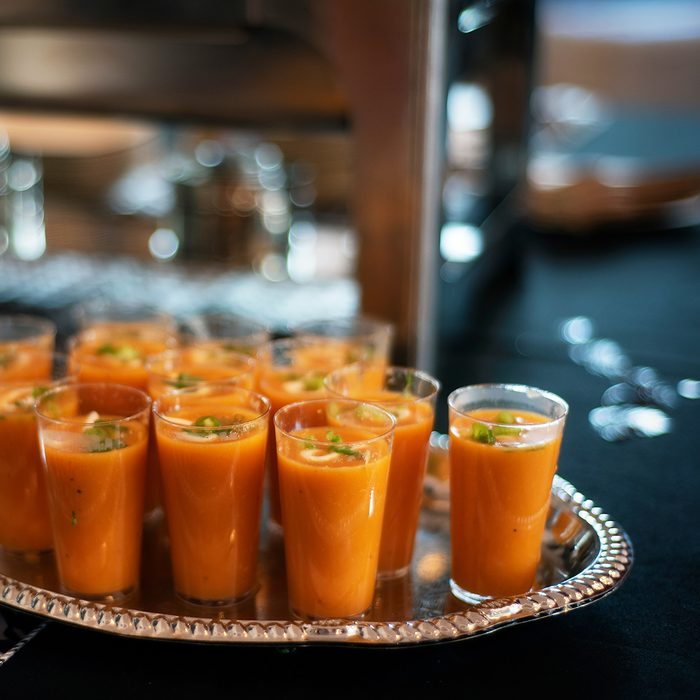 tomato or butternut squash soup shooters on buffet table