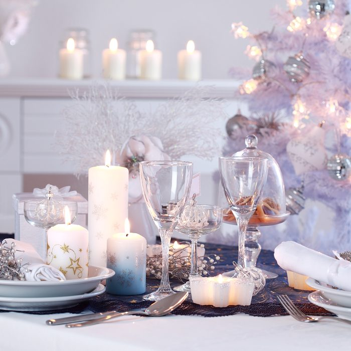 Place setting for Christmas in white with white Christmas tree