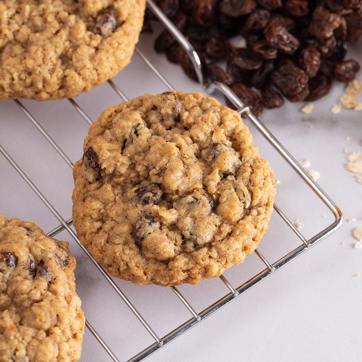 Cinnamon Raisin Oatmeal Cookies with Raw Ingredients on a Marble Counter