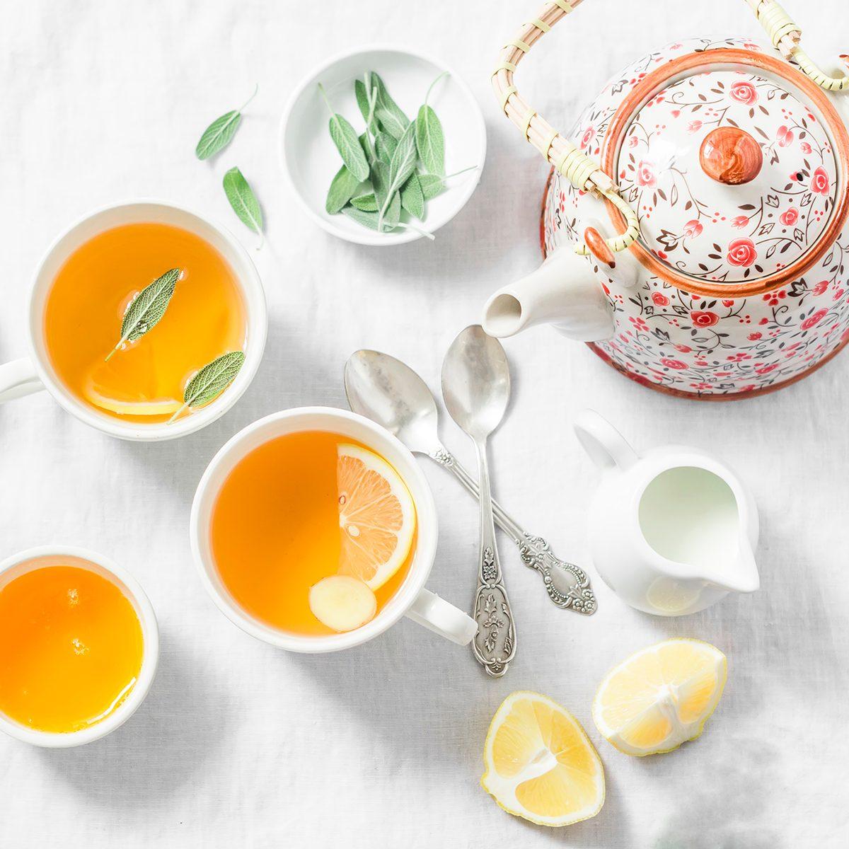 Cough tea. Green tea with lemon, ginger, sage on a light background