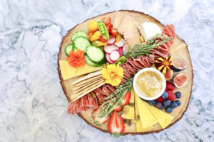 """Influencer Marissa Mullen's cheese plates often contain cheese, fruits and veggies, honeycomb, edible flowers and what she calls a """"salami river."""""""