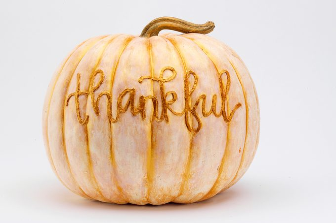 Cream and gold painted pumpkin with textured script writing