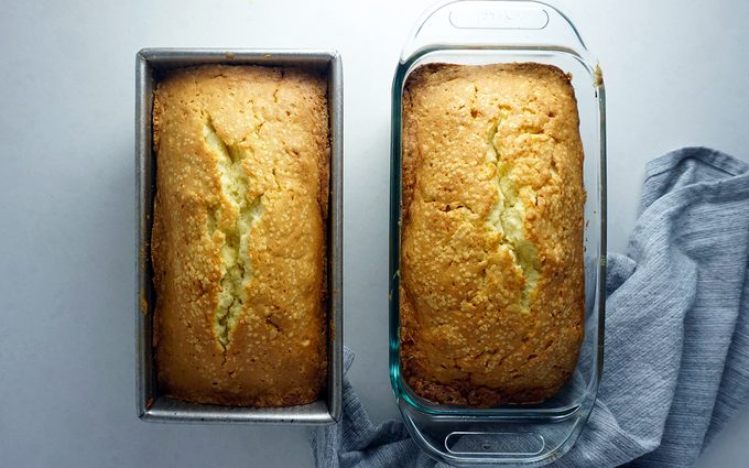 Two freshly baked pound cakes still in their loaf pans