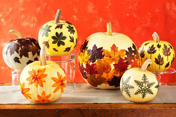 Pumpkins decorated with glued on fall leaves