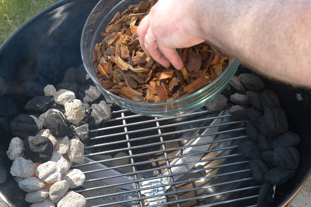 adding woodchips to grill