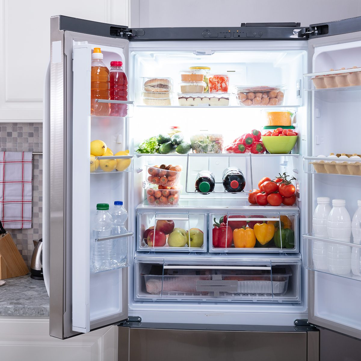 An Open Refrigerator Filled With Fresh Fruits And Vegetables