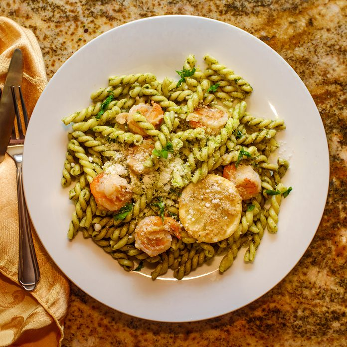 Breaded shrimp with gemelli twin tube pasta in homemade pesto sauce; Shutterstock ID 1148709638; Job (TFH, TOH, RD, BNB, CWM, CM): Taste of Home