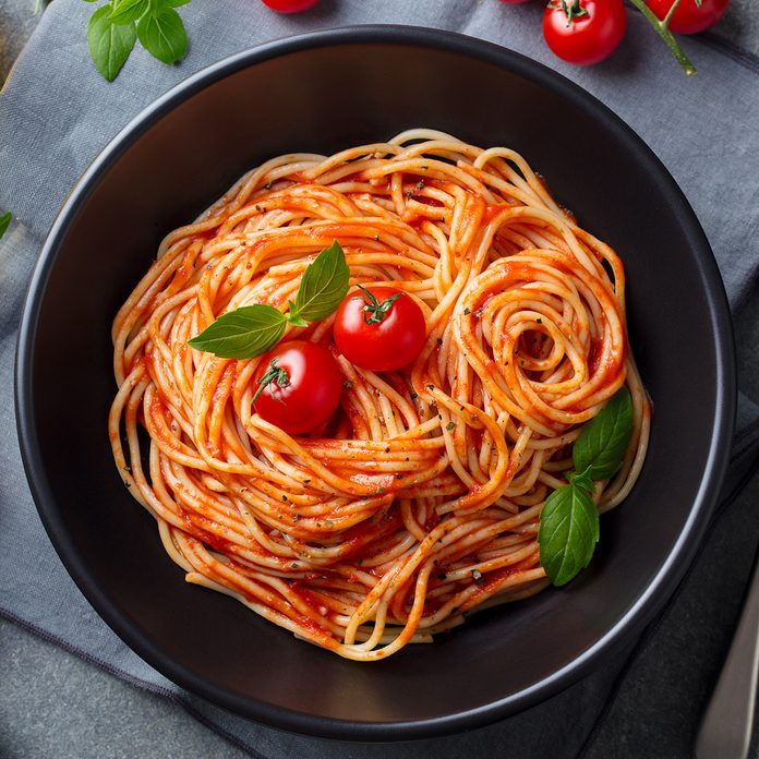 Pasta, spaghetti with tomato sauce in black bowl on grey stone background. Top view.; Shutterstock ID 1168833847; Job (TFH, TOH, RD, BNB, CWM, CM): Taste of Home