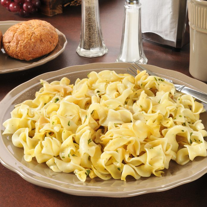 A plate of buttered noodles with dinner rolls; Shutterstock ID 139217111; Job (TFH, TOH, RD, BNB, CWM, CM): Taste of Home