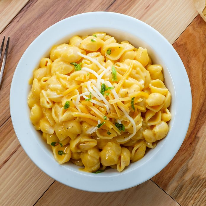 Delicious macaroni and cheddar cheese shell noodles in a bowl; Shutterstock ID 1496072468; Job (TFH, TOH, RD, BNB, CWM, CM): Taste of Home
