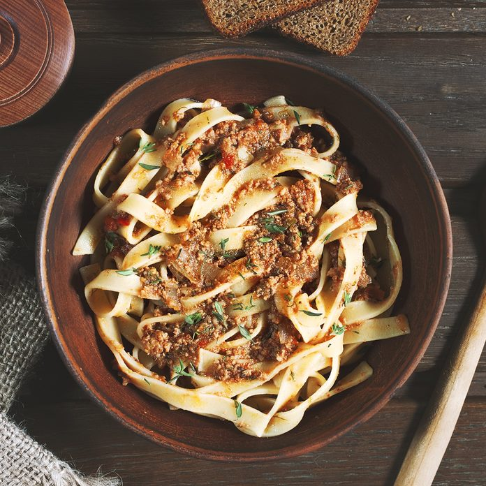 pasta tagliatelle bolognese on the wooden table, rustic style; Shutterstock ID 428277280; Job (TFH, TOH, RD, BNB, CWM, CM): Taste of Home