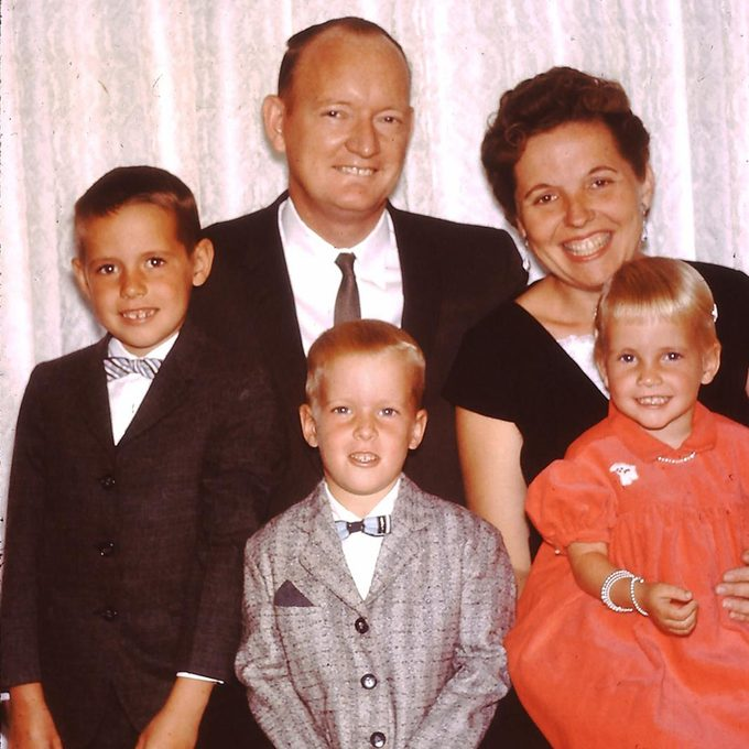 A father and mother pose with their three children 1960s