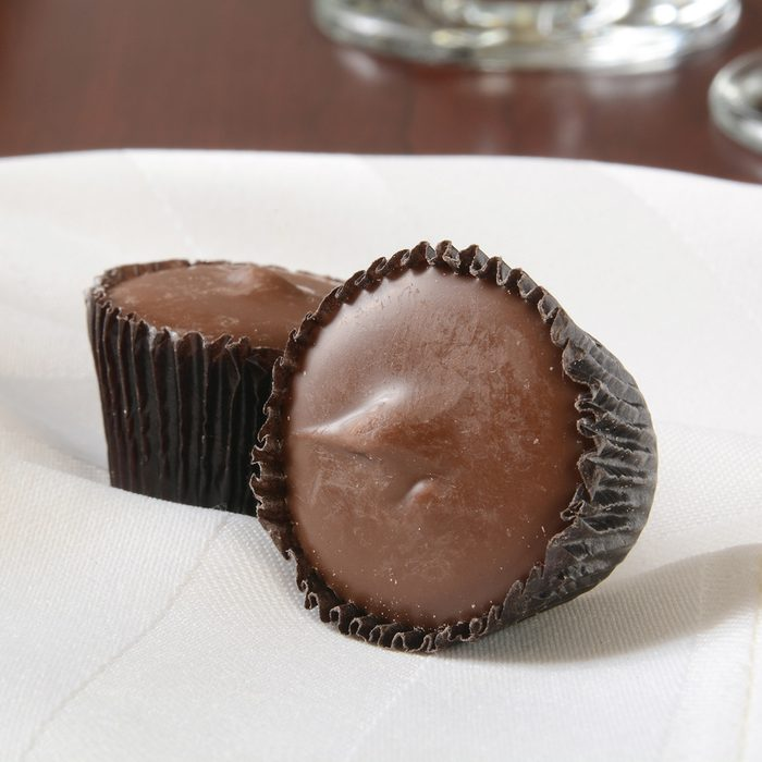 Small peanut butter cups on a white napkin