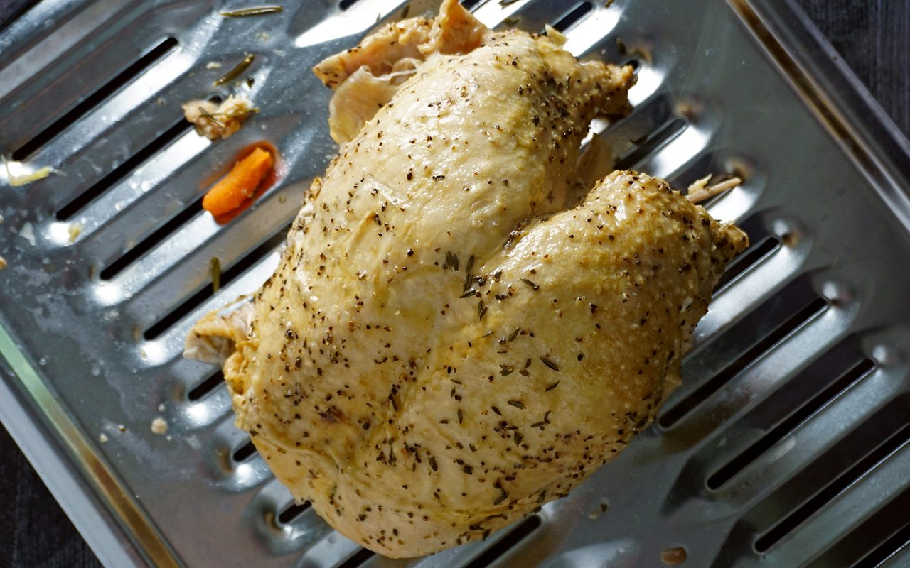 fully cooked instant pot turkey on a broiler pan ready to crisp the skin