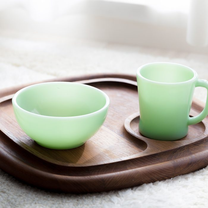 Vintage mug and bowl on wooden tray