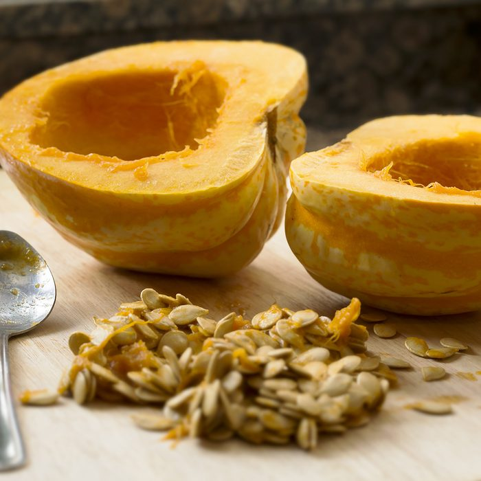 Winter squash cut in half with spoon and seeds scooped out.; Shutterstock ID 175357406; Job (TFH, TOH, RD, BNB, CWM, CM): TOH