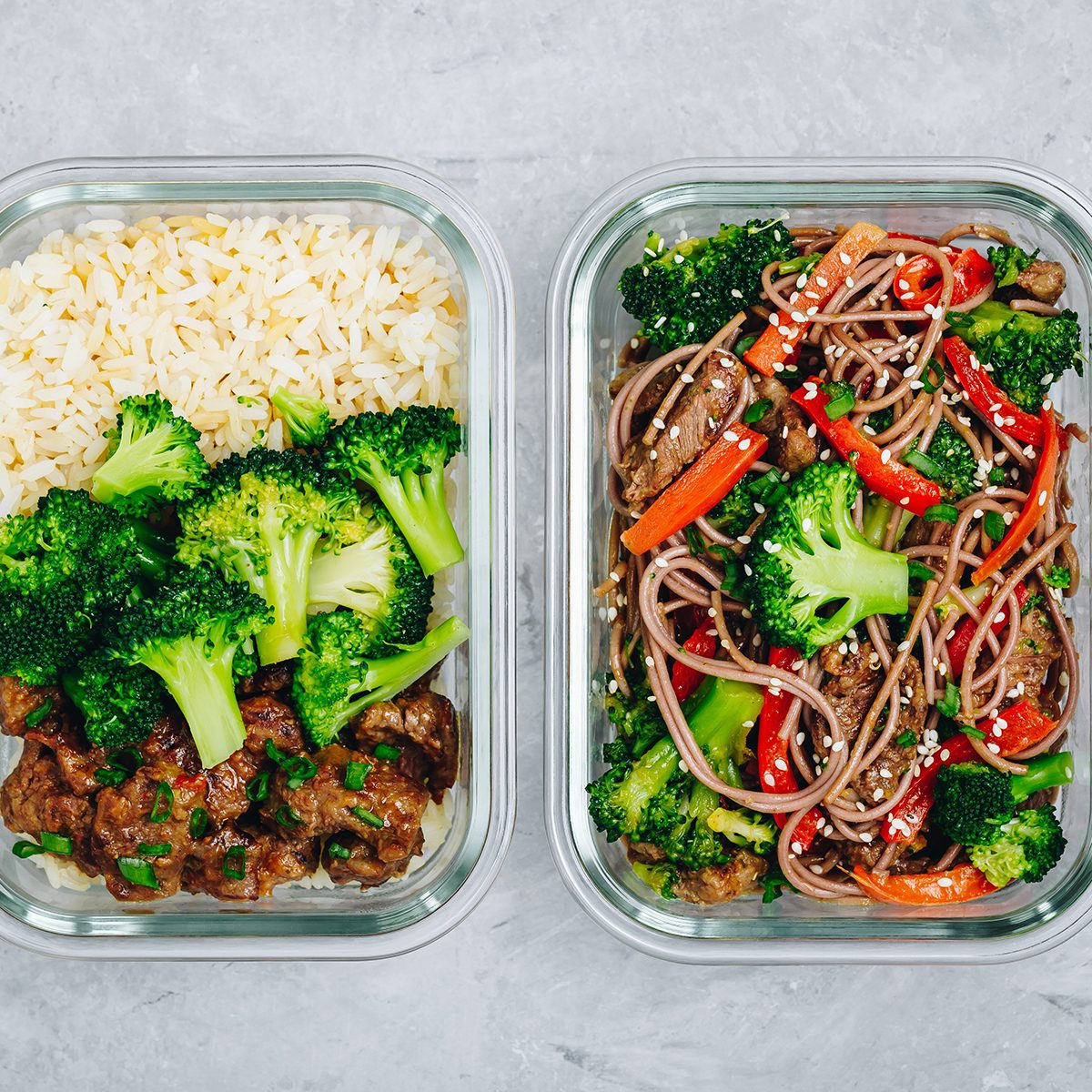 Two takeout containers of food