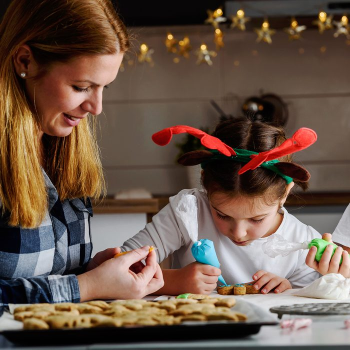 Mother with children baking cookies for Christmas