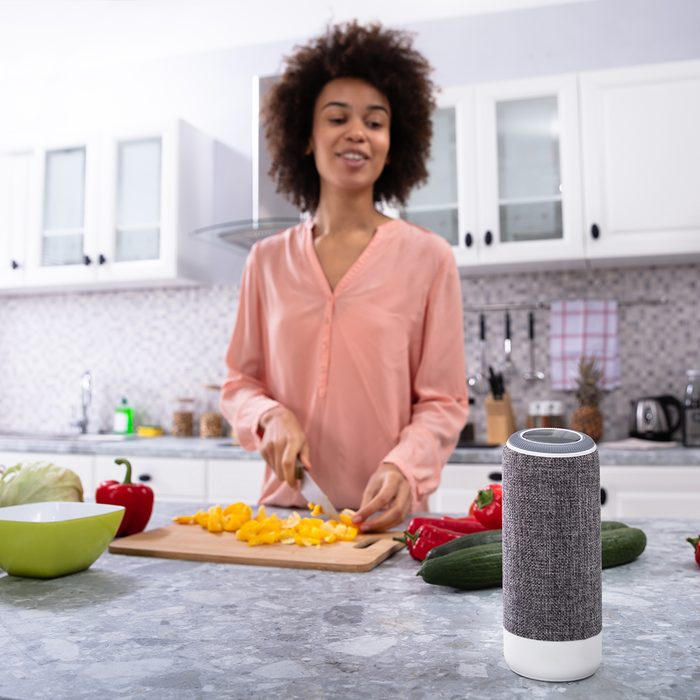 kitchens get smart, 2020 food trends, Wireless Speaker In Front Of Woman Cutting Vegetables On Chopping Board In The Kitchen; Shutterstock ID 1282479844; Job (TFH, TOH, RD, BNB, CWM, CM): Taste of Home