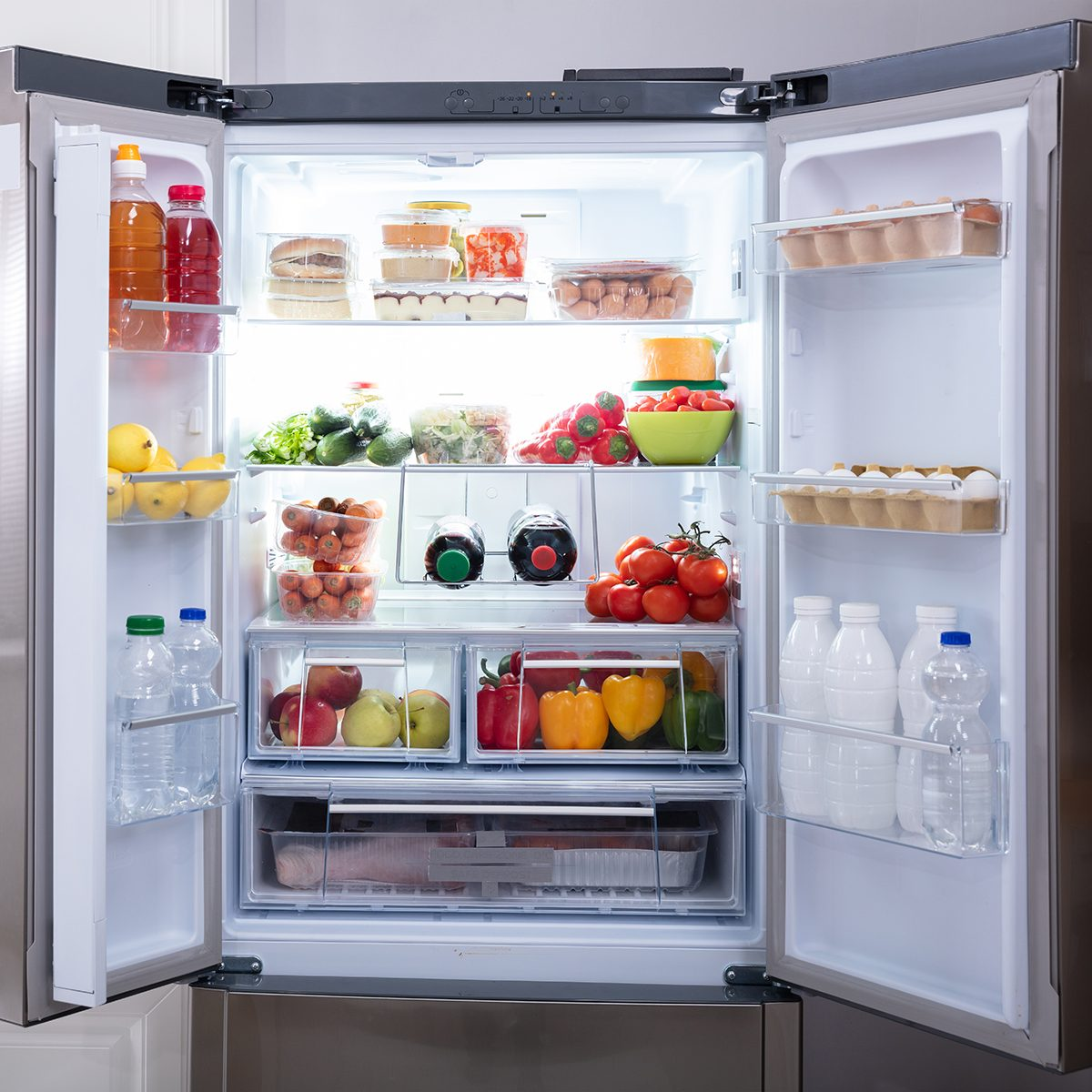 An Open Refrigerator Filled With Fresh Fruits And Vegetables; Shutterstock ID 1303093705