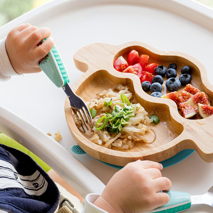 baby led weaning, 2020 food trends,Baby is eating homemade healthy solid food by himself by BLW method (Baby Led Weaning) on the highchair at home, learning how to use spoon, fork, utensils.; Shutterstock ID 1502821766; Job (TFH, TOH, RD, BNB, CWM, CM): Taste of Home