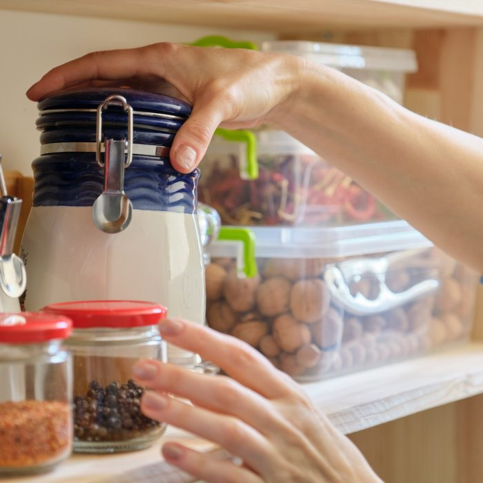 Woman in the kitchen with can of dry mint, food storage, pantry.; Shutterstock ID 1566195697; Job (TFH, TOH, RD, BNB, CWM, CM): TOH