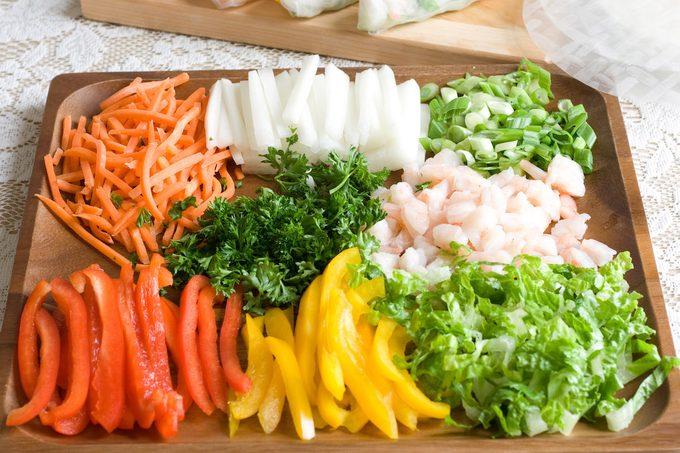 Preparing vegetable to make fresh spring rolls.