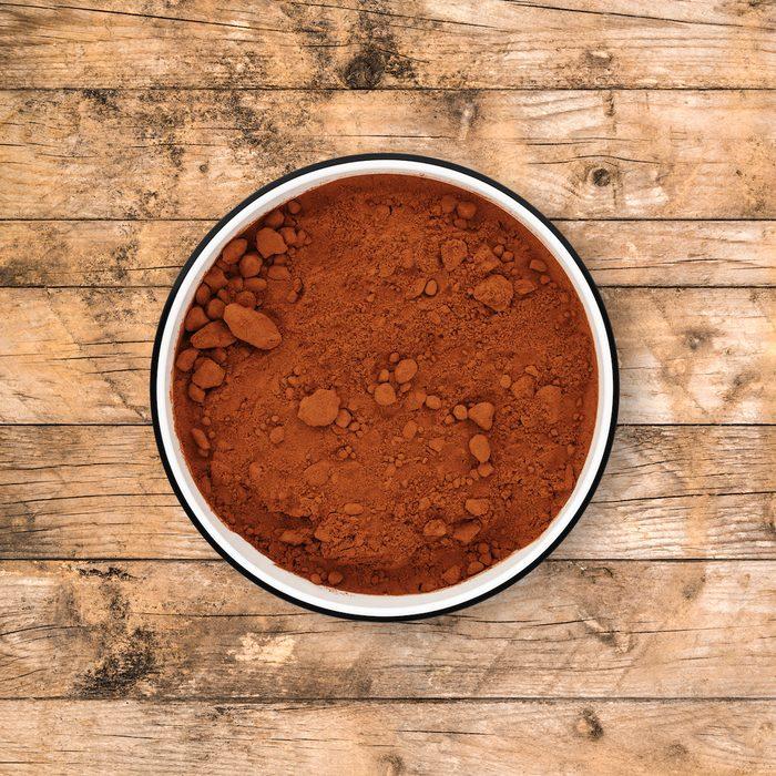 Cocoa powder in circle bowl.